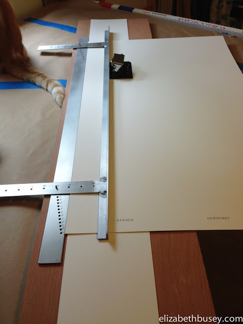A measuring jig allows me to cut the mat window without expensive devices.