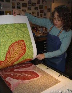 Pulling up a red leaf linocut