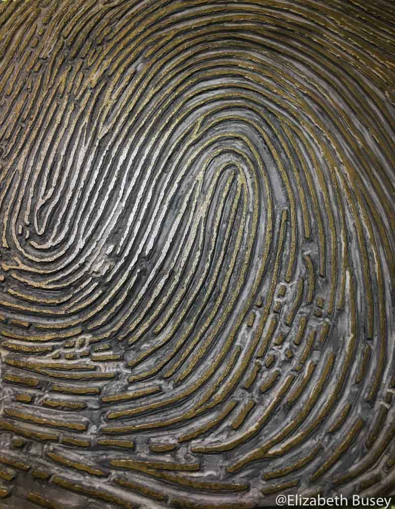 linoleum carved with fingerprint, gold ink
