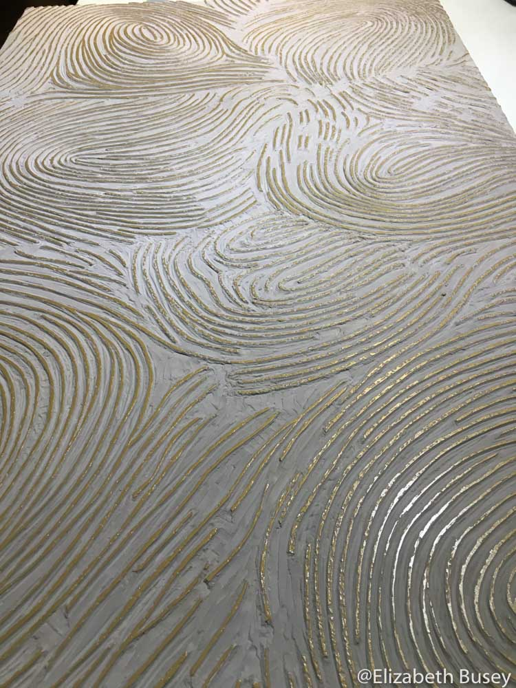 Lino block with large fingerprints.