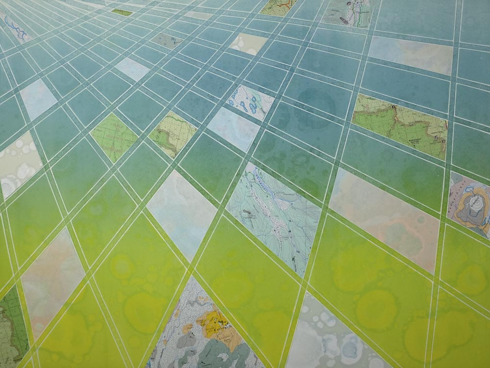 Collage monoprint with maps.