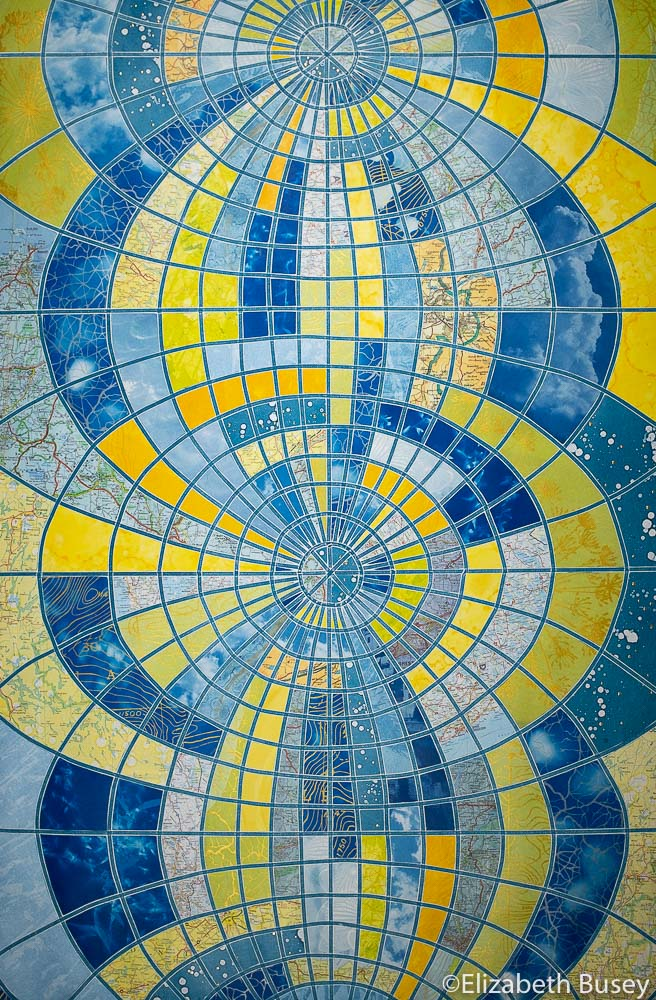 Vertical monoprint collage globe transformation blues yellow-green orange stained glass cyanotype vintage maps Elizabeth Busey 36 x 24 inch